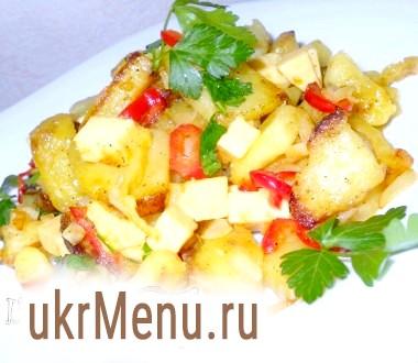 Картопля з плавленим сиром і овочами