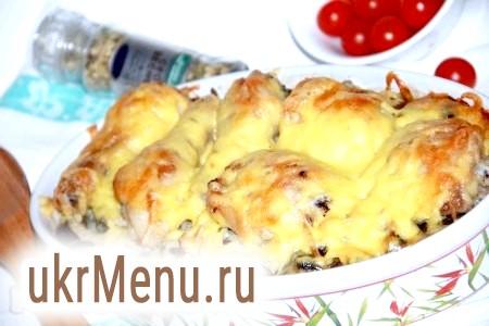 Курячі ніжки з картоплею та грибами в духовці