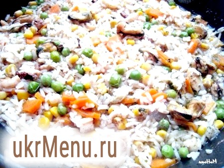 Фото - Через 15-20 хвилин рис з морепродуктами буде готовий.