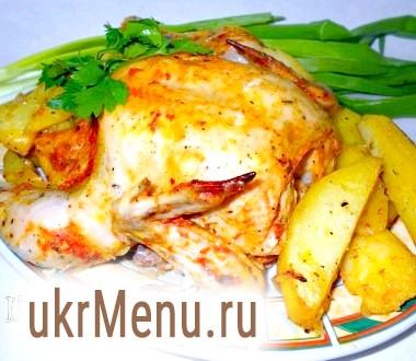 Курча в томатно-сметанному соусі, запечена з картоплею в рукаві
